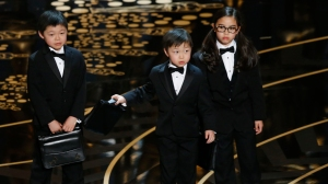 Children acting as accountants from PricewaterhouseCoopers take the stage at the 88th Academy Awards in Hollywood, California February 28, 2016.   REUTERS/Mario Anzuoni  - RTS8GOV